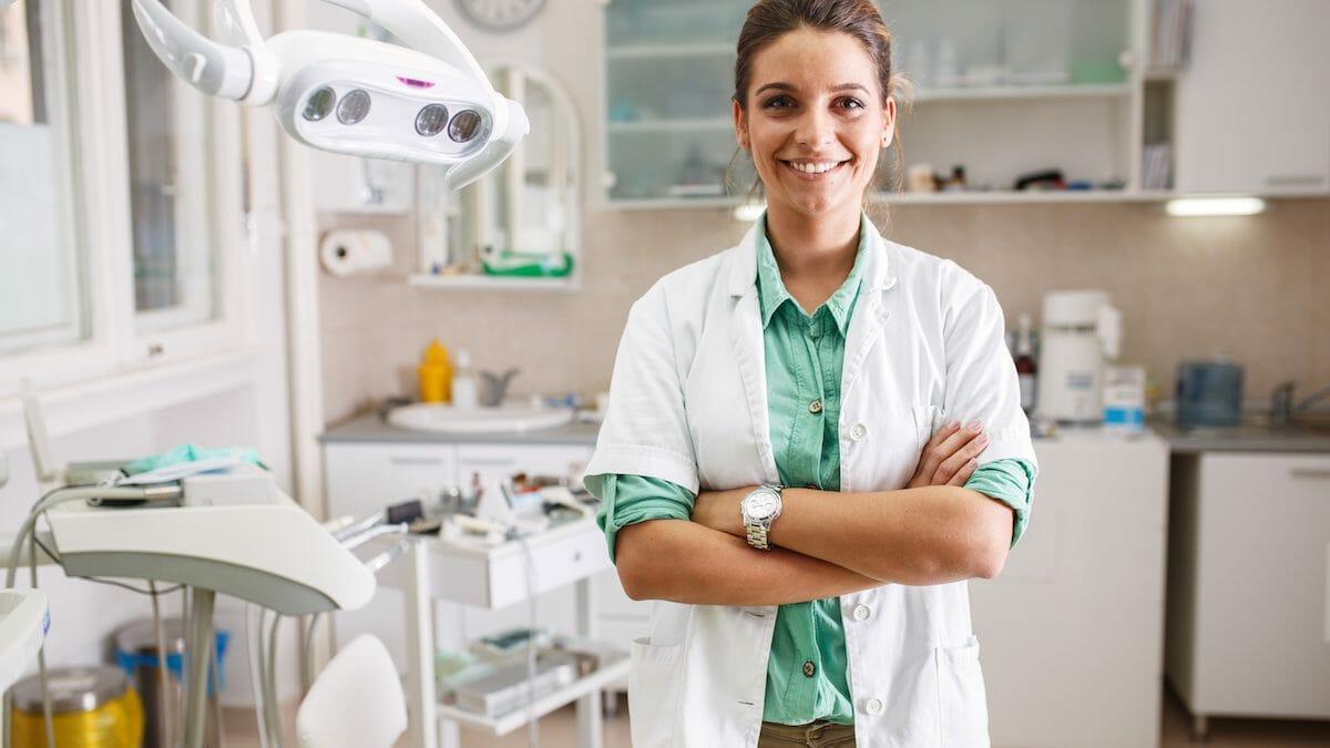 woman dentist in office
