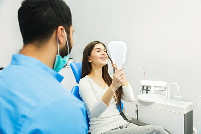 Dental Patient looking in mirror