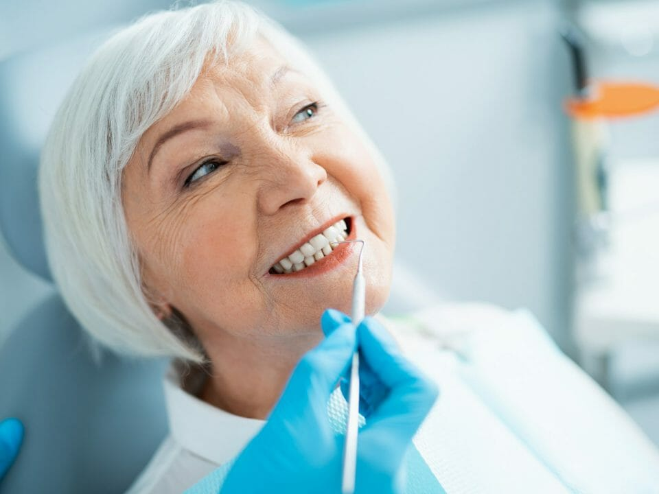 Woman getting teeth cleaned
